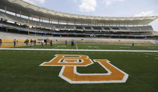 "FILE - In this Aug. 18, 2014, file photo, the Baylor University logo is displayed on the football field at McLane Stadium in Waco, Texas. A federal judge has ordered a law firm to turn over thousands of records that lawyers say should give a fuller accounting of how Baylor University responded to sexual assault allegations made by students. Judge Robert Pitman ruled Thursday, March 28, 2019, that Philadelphia-based Pepper Hamilton must produce all materials related to its internal review that resulted in a 2016 summary report finding ""institutional failure at every level."" (AP Photo/Waco Tribune-Herald via AP, File)"