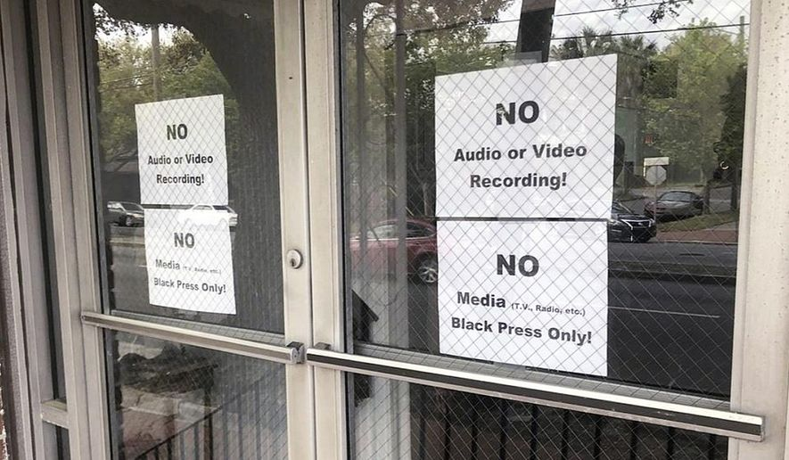 In this Wednesday, March 27, 2019 photo, signs posted on the doors of the Bolten Street Baptist Church are seen during a meeting coordinated to garner support for one black candidate in Savannah's mayoral race, in Savannah, Ga. Organizers of a meeting to discuss an upcoming mayoral race in Georgia barred reporters from attending, unless they were African-American. (Eric Curl/Savannah Morning News via AP)