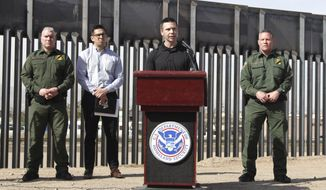 "Customs and Border Protection Commissioner Kevin McAleenan, center, announced that the Trump administration will temporarily reassign several hundred border inspectors during a news conference at the border in El Paso, Texas, Wednesday, March 27, 2019. McAleenan said the reassignment of 750 border inspectors would mean longer waits at crossings as the busy Easter holiday nears but that it was necessary to address what he called ""an operational crisis."" The reassigned officers will process migrants, provide transportation and perform hospital watches for migrants who require medical attention. It is unknown when they will return to their regular duties. (AP Photo/Cedar Attanasio)"