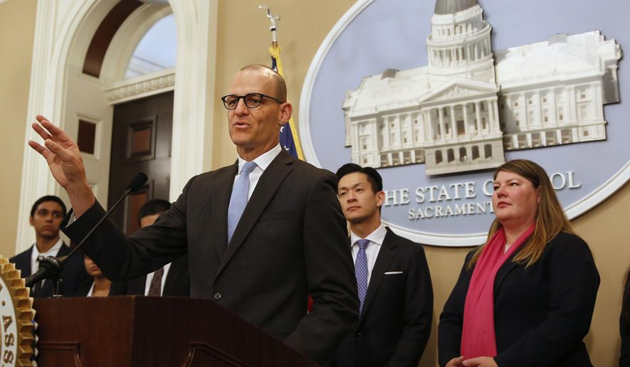 Assemblyman Kevin McCarty, D-Sacramento, left, answers questions concerning a proposed package of bills dealing with the recent college admissions scandal, during a news conference, Thursday, March 28, 2019, in Sacramento, Calif. McCarty, along with Democratic Assembly members Evan Low, left, of Campbell, Tasha Boerner Horvath, of Oceanside, right, and Phil Ting, of San Francisco, unseen, unveiled a half-dozen measures that would require that three college administrators sign off on special admissions and a ban upon preferential admissions for students related to the institution's donors of alumni. (AP Photo/Rich Pedroncelli)