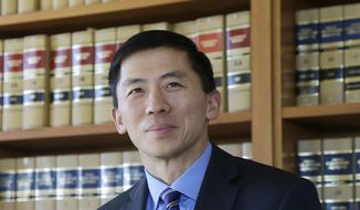 FILE - In this Jan. 13, 2017 file photo California Supreme Court Associate Justice Goodwin Liu pauses in his office in San Francisco. The California Supreme Court justice says the death penalty system in the most populous state is dysfunctional, expensive and doesn't deliver justice in a timely way.  Liu made the comments in an unusual opinion issued Thursday, March 28, 2019, after the full court unanimously upheld Thomas Potts' death sentence. Potts was convicted in a 1997 killing of an elderly couple. (AP Photo/Jeff Chiu, File)