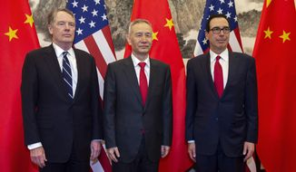 China's Vice Premier Liu He, center, pose for a photo with U.S. Treasury Secretary Steven Mnuchin, right, and U.S. Trade Representative Robert Lighthizer at Diaoyutai State Guesthouse in Beijing Friday, March 29, 2019. (Nicolas Asfouri via AP, Pool)
