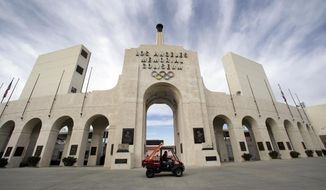 FILE - This Jan. 13, 2016 file photo shows the peristyle of the Los Angeles Memorial Coliseum in Los Angeles. The University of Southern California's sale of naming rights for Los Angeles Memorial Coliseum is being criticized as dishonoring the historic stadium's dedication as a memorial to soldiers who fought and died in World War I. USC announced last year that the stadium will be renamed United Airlines Memorial Coliseum as part of a $270 million renovation of the facility, which opened in 1923. (AP Photo/Nick Ut, File)