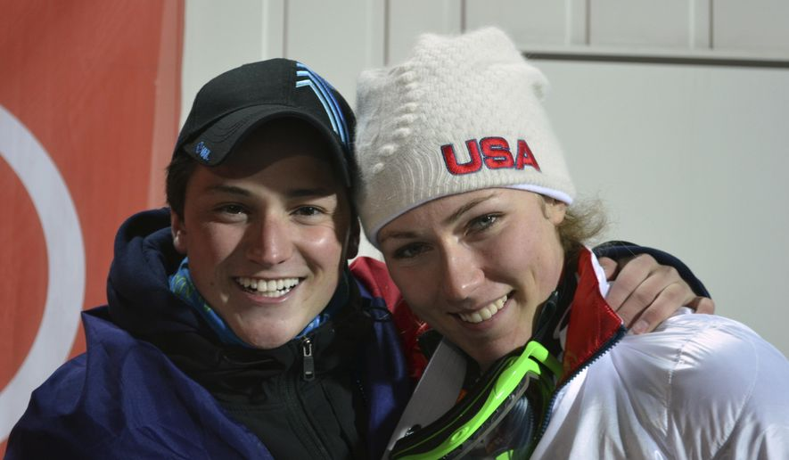 In this February 2014 photo provided by Kathleen Walsh, Thomas Walsh and Mikaela Shiffrin pose in Sochi, Russia. Ten years ago, ski racer Thomas Walsh was diagnosed with cancer that ended up taking his pelvis. By his side that day was Olympic champion Mikaela Shiffrin. She remains one of his biggest fans as Walsh rises through the ranks as a Paralympian. (Kathleen Walsh via AP)