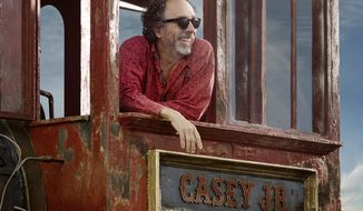 "This image released by Disney shows director Tim Burton on the set of ""Dumbo."" (Leah Gallo/Disney via AP)"