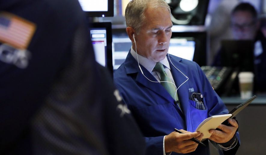 FILE- In this March 18, 2019, file photo trader Timothy Nick works on the floor of the New York Stock Exchange. The U.S. stock market opens at 9:30 a.m. EDT on Thursday, March 28. (AP Photo/Richard Drew)