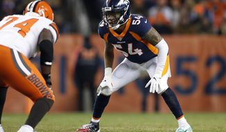 FILE - In this Dec. 15, 2018, file photo, Denver Broncos inside linebacker Brandon Marshall (54) lines up against Cleveland Browns offensive tackle Chris Hubbard (74) during the first half of an NFL football game in Denver. The Oakland Raiders filled two more holes on their depth chart Thursday, March 28, 2019, by signing linebacker Brandon Marshall and running back Isaiah Crowell to one-year contracts. (AP Photo/Jack Dempsey, File)