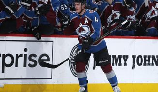 Colorado Avalanche defenseman Tyson Barrie, front, is congratulated for his goal against the Vegas Golden Knights during the second period of an NHL hockey game Wednesday, March 27, 2019, in Denver. (AP Photo/David Zalubowski)