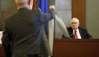 Former U.S. Sen. Harry Reid sits in the witness stand, Thursday, March 28, 2019, in Las Vegas. Reid testified in his negligence lawsuit against the maker of an exercise device. (AP Photo/John Locher)