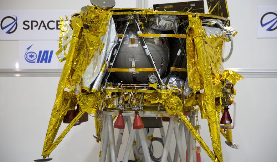 """FILE - This Monday, Dec. 17, 2018 file photo shows the SpaceIL lunar module on display in a special """"clean room"""" where the spacecraft is being developed, during a press tour of their facility near Tel Aviv, Israel. It's on track to land on the moon April 11. On Thursday, March 28, 2019, the XPrize Foundation announced it's offering a $1 million Moonshot Award for a successful lunar landing. (AP Photo/Ariel Schalit)"""
