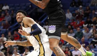 Sacramento Kings center Willie Cauley-Stein (00) grabs a rebound over New Orleans Pelicans forward Christian Wood (35) during the first half of an NBA basketball game in New Orleans, Thursday, March 28, 2019. (AP Photo/Tyler Kaufman)