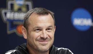 Louisville head coach Jeff Walz smiles as he answers questions from the media during a news conference at the NCAA women's college basketball tournament, Thursday, March 28, 2019, in Albany, N.Y. Louisville faces Oregon State in regional semifinal game on Friday. (AP Photo/Kathy Willens)