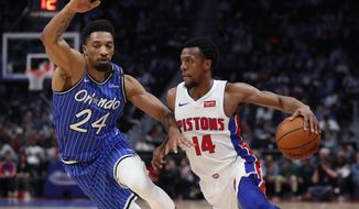 Detroit Pistons guard Ish Smith (14) drives on Orlando Magic center Khem Birch (24) during the first half of an NBA basketball game Thursday, March 28, 2019, in Detroit. (AP Photo/Carlos Osorio)