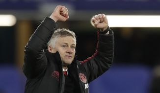 FILE - In this Monday, Feb. 18, 2019 file photo, Manchester United caretaker head coach Ole Gunnar Solskjaer applauds fans at the end of the English FA Cup fifth round soccer match between Chelsea and Manchester United at Stamford Bridge stadium in London. Manchester United on Thursday March 28, 2019, made coach Ole Gunnar Solskjaer a permanent hire, with a three-year contract. (AP Photo/Matt Dunham, File)