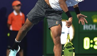 Felix Auger-Aliassime, of Canada, serves to Borna Coric, of Croatia, during the quarterfinals of the Miami Open tennis tournament Wednesday, March 27, 2019, in Miami Gardens, Fla. (AP Photo/Jim Rassol)