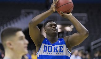 Duke forward Zion Williamson shoots during an NCAA men's college basketball practice in Washington, Thursday, March 28, 2019. Duke plays Virginia Tech in an East Regional semifinal game on Friday. (AP Photo/Alex Brandon)