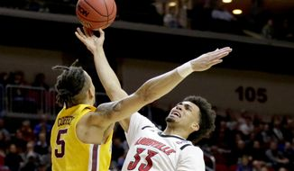Louisville's Jordan Nwora (33) goes to the basket against Minnesota's Amir Coffey (5) during the first half of a first round men's college basketball game in the NCAA Tournament, in Des Moines, Iowa, Thursday, March 21, 2019. (AP Photo/Nati Harnik)