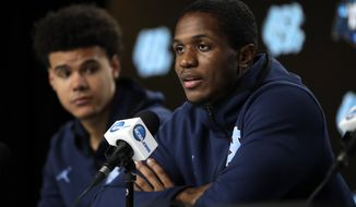 North Carolina's Kenny Williams, right, answers a question as teammate Cameron Johnson listens during a news conference at the NCAA men's college basketball tournament Thursday, March 28, 2019, in Kansas City, Mo. North Carolina plays Auburn in a Midwest Regional semifinal on Friday. (AP Photo/Orlin Wagner)