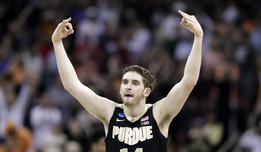 Purdue's Ryan Cline celebrates after hitting a shot against Tennessee during the second half of a men's NCAA Tournament college basketball South Regional semifinal game Thursday, March 28, 2019, in Louisville, Ky. (AP Photo/Michael Conroy)