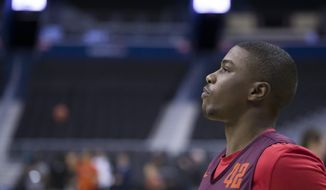 Virginia Tech guard Ty Outlaw looks at the basket during an NCAA men's college basketball practice in Washington, Thursday, March 28, 2019. Virginia Tech plays Duke in an East Regional semifinal game on Friday. (AP Photo/Alex Brandon)