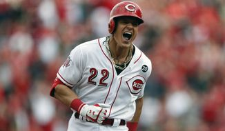 Cincinnati Reds' Derek Dietrich reacts as he runs the bases on his three-run home run off Pittsburgh Pirates relief pitcher Richard Rodriguez in the seventh inning of a baseball game, Thursday, March 28, 2019, in Cincinnati. (AP Photo/Gary Landers)