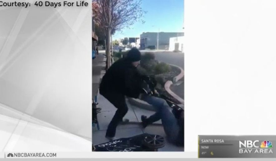 Police in San Francisco are looking for a man who was caught on video repeatedly kicking an elderly anti-abortion protester outside a Planned Parenthood clinic. (NBC Bay Area)