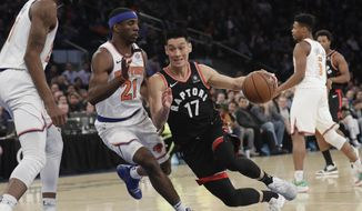 Toronto Raptors' Jeremy Lin (17) drives past New York Knicks' Damyean Dotson (21) during the first half of an NBA basketball game Thursday, March 28, 2019, in New York. (AP Photo/Frank Franklin II)