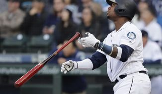 Seattle Mariners' Tim Beckham watches his two-run home run against the Boston Red Sox during the third inning of a baseball game Thursday, March 28, 2019, in Seattle. The homer was Beckham's second of the day. (AP Photo/Ted S. Warren)