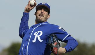 FILE - In this Wednesday, Feb. 20, 2019 file photo, Kansas City Royals pitcher Kyle Zimmer throws during spring training baseball practice in Surprise, Ariz. Kansas City right-hander Kyle Zimmer finally made it to the major leagues after a prank by Royals manager Ned Yost, who told the pitcher he was going to Triple-A Omaha. What Yost didn't say at first was that Zimmer was headed there for the Royals' exhibition game and then would leave with the big league team for Kansas City and the opener against the Chicago White Sox.(AP Photo/Charlie Riedel, File)