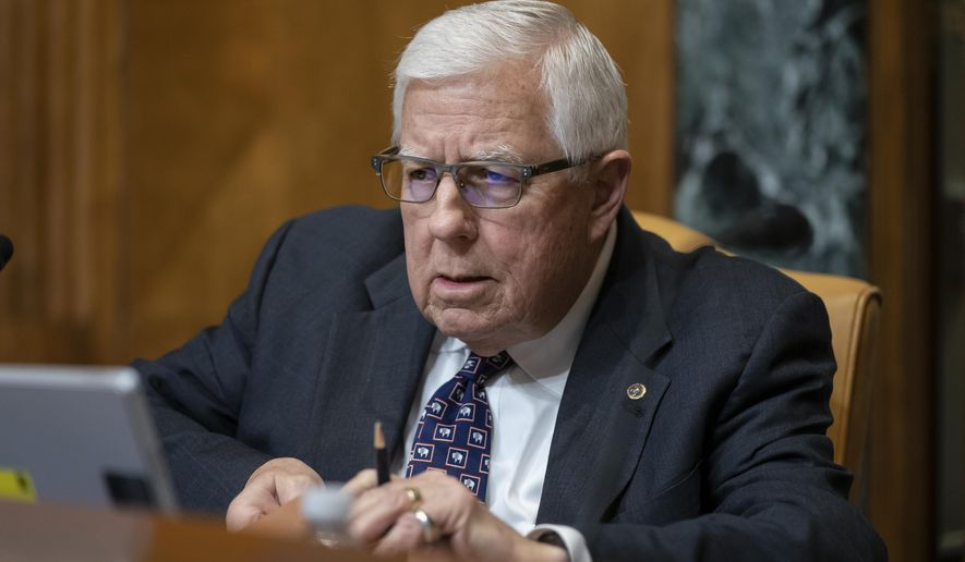 Sen. Mike Enzi, R-Wyo., chairman of the Senate Budget Committee, prepares for the markup of the fiscal year 2020 budget resolution, on Capitol Hill in Washington, Wednesday, March 27, 2019. (AP Photo/J. Scott Applewhite) **FILE**