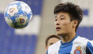 FILE - In this Tuesday, Jan. 29, 2019 file photo, newly signed Espanyol soccer player Wu Lei eyes the ball during his official presentation at RCDE stadium in Cornella Llobregat, Spain. When Barcelona takes on city rival Espanyol on Saturday March 30, 2019, the Catalan derby will feature Lionel Messi, the Argentina star the world is used to watching, and the Wu Lei, the Chinese sensation that China is starting to fall in love with. (AP Photo/Manu Fernandez, File)