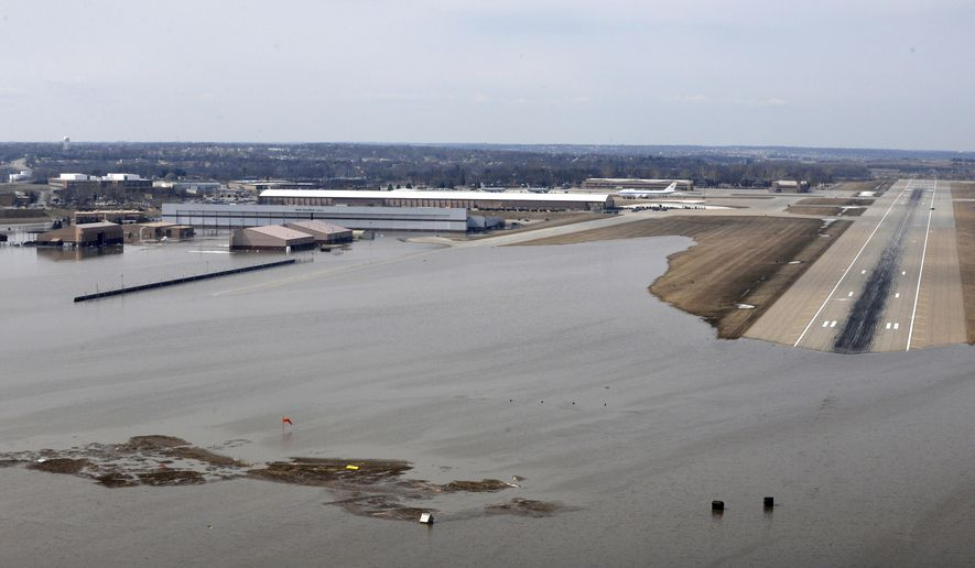 FILE - This March 17, 2019 file photo provided by the U.S. Air Force shows an aerial view of Offutt Air Force Base and surrounding areas in Nebraska affected by flood waters. After this spring's massive flooding along the Missouri River, many want to blame the agency that manages the river's dams for making the disaster worse, but it may not be that simple. The U.S. Army Corps of Engineers says much of the water that created this month's flooding came from rain and melting snow that flowed into the river downstream of all the dams, and at the same time, massive amounts of water filled the reservoirs and some had to be released. (Tech. Sgt. Rachelle Blake/U.S. Air Force via AP, File)