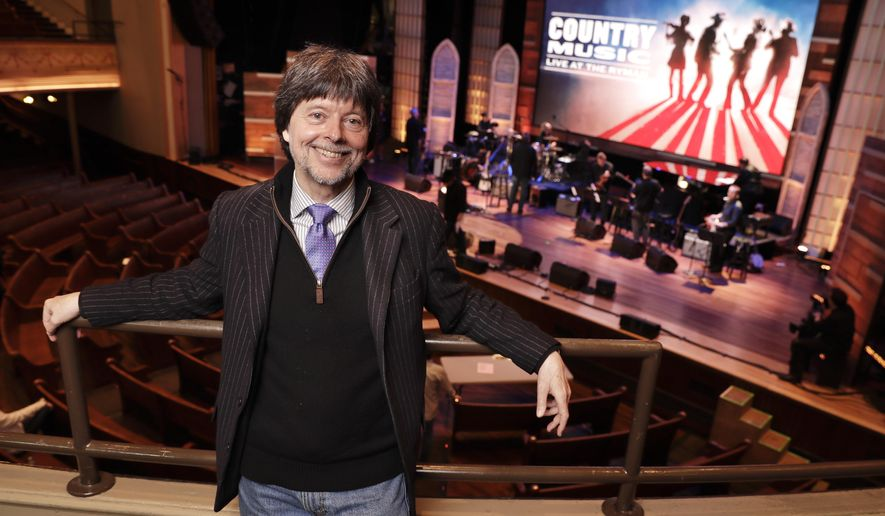 "Filmmaker Ken Burn poses in the Ryman Auditorium Wednesday, March 27, 2019, in Nashville, Tenn. The Ryman was home to the Grand Ole Opry from 1943 to 1974. Burns hit the road this month on a bus trip to preach the gospel of ""Country Music,"" his new PBS film airing in September. (AP Photo/Mark Humphrey)"