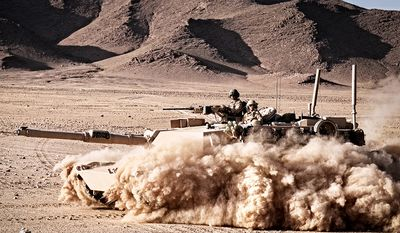 The M1 Abrams is a third-generation American main battle tank named after General Creighton Abrams and designed by Chrysler Defense (now General Dynamics Land Systems). Designed as a highly mobile main-battle tank for modern armored ground warfare,[14] the M1 is well armed and heavily armored. The Abrams introduced several notable and innovative features such as a powerful 1500 hp AGT1500 multifuel turbine engine, sophisticated Chobham composite armor, a computer fire control system and separate ammunition storage in a blow-out compartment along with NBC protection for crew safety. While the initial models of the M1 were armed with a licensed-produced 105 mm Royal Ordnance L7 gun, later variants feature a licensed Rheinmetall 120 mm L/44 for increased firepower. Weighing nearly 68 short tons , it is one of the heaviest main battle tanks in service. Three main versions of the M1 Abrams have been deployed, the M1, M1A1, and M1A2, incorporating improved armament, protection, and electronics with each new model. These improvements and other upgrades to in-service tanks have allowed this long-serving vehicle to remain in front-line service