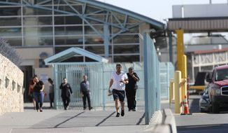 """Pedestrians enter the U.S. from Mexico at a border crossing in El Paso, Texas, Friday, March 29, 2019. Threatening drastic action against Mexico, President Donald Trump declared on Friday he is likely to shut down America's southern border next week unless Mexican authorities immediately halt all illegal immigration. Such a severe move could hit the economies of both countries, but the president emphasized, """"I am not kidding around."""" (AP Photo/Gerald Herbert)"""