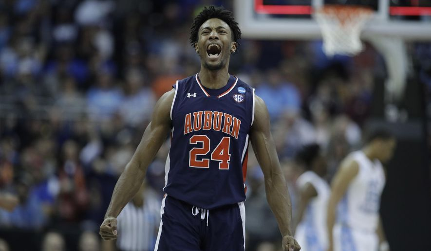 Auburn's Anfernee McLemore celebrates at the end of the first half of a men's NCAA tournament college basketball Midwest Regional semifinal game against North Carolina Friday, March 29, 2019, in Kansas City, Mo. (AP Photo/Charlie Riedel)