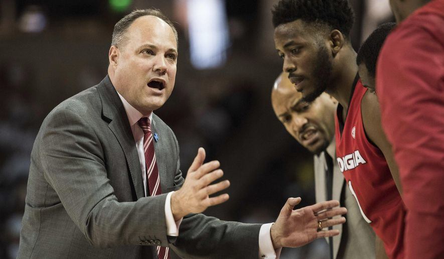 FILE - In this Saturday, Feb. 4, 2017 file photo, Georgia head coach Mark Fox communicates with players during the first half of an NCAA college basketball game against South Carolina in Columbia, S.C. California has hired Mark Fox as its new men's basketball coach. A person familiar with the hiring said on Friday, March, 29, 2019 that Fox got the job five days after Wyking Jones was fired. The person spoke on condition of anonymity because the school had not made a formal announcement. Stadium first reported that Fox would get the job. (AP Photo/Sean Rayford, File)