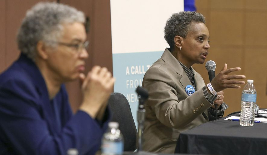 In this March 24, 2019 photo, Chicago mayoral candidate Lori Lightfoot, right, participates in a candidate forum sponsored by One Chicago For All Alliance at Daley College in Chicago. Lightfoot and Toni Preckwinkle, left, are competing to make history by becoming the city's first black, female mayor. On issues their positions are similar. But their resumes are not, and that may make all the difference when voters pick a new mayor on Tuesday. (AP Photo/Teresa Crawford)