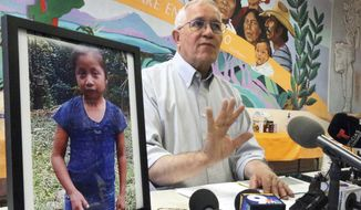 FILE - In this Dec. 15, 2018, file photo, Annunciation House director Ruben Garcia answers questions from the media after reading a statement from the family of Jakelin Caal Maquin, pictured at left, during a press briefing at Casa Vides in downtown El Paso, Texas. An autopsy has found that the 7-year-old girl from Guatemala who was detained by the U.S. Border Patrol died of a bacterial infection. Jakelin died on Dec. 8, just over a day after she was apprehended by Border Patrol agents with her father. (Rudy Gutierrez/The El Paso Times via AP, File)