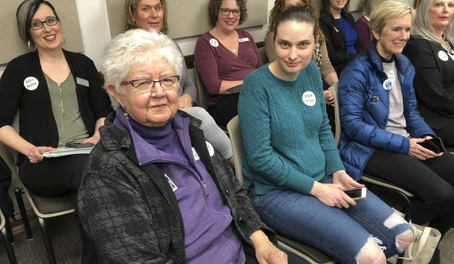 In this Thursday, March 28, 2019 photo, citizens gather to testify against a resolution that seeks to nullify North Dakota's 1975 support of the Equal Rights Amendment at a legislative hearing at the state Capitol in Bismarck, North Dakota. Opponents call the resolution a thinly-veiled response to offset revived efforts to enshrine the near half-century-old gender-equality measure in the U.S. Constitution. (AP Photo/James MacPherson)