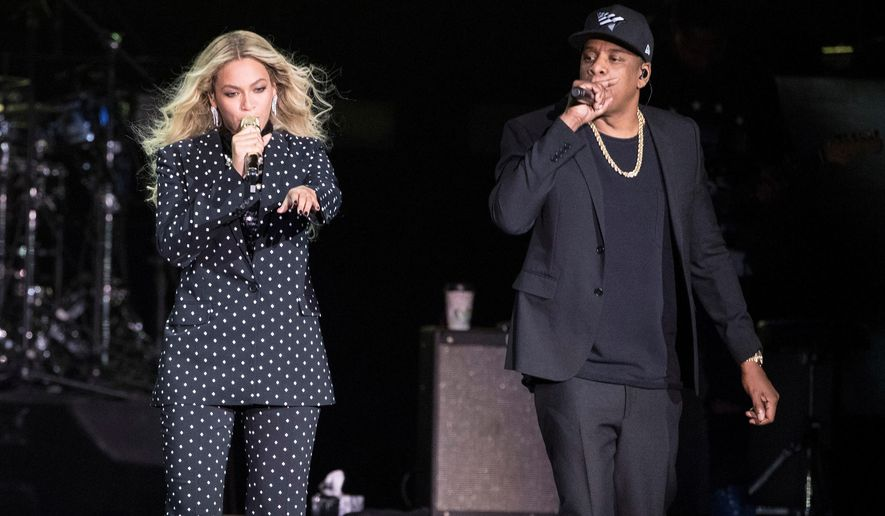 FILE - In this Nov. 4, 2016 file photo, Beyonce and Jay-Z perform during a Democratic presidential candidate Hillary Clinton campaign rally in Cleveland. The pair received the LGBTQ advocacy group's Vanguard Award on Thursday during its 30th annual media awards ceremony in Beverly Hills, Calif. (AP Photo/Matt Rourke, File)