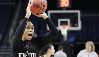 Louisville guard Asia Durr passes during practice at the NCAA women's college basketball tournament, Thursday, March 28, 2019, in Albany, N.Y. Louisville faces Oregon State in a regional semifinal game on Friday. (AP Photo/Kathy Willens)