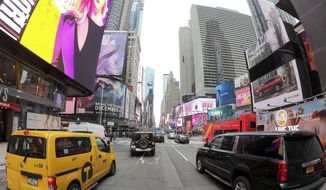 Motorists roll south on 7th Avenue in Times Square, Friday, March 29, 2019, in New York. (AP Photo/Julie Jacobson) ** FILE **