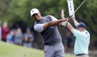 Tiger Woods hits on the second hole during round-robin play at the Dell Technologies Match Play Championship golf tournament, Friday, March 29, 2019, in Austin, Texas. (AP Photo/Eric Gay)