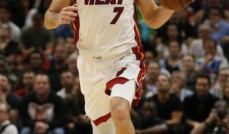 Miami Heat guard Goran Dragic (7) brings the ball upcourt against the Dallas Mavericks during the second half of an NBA basketball game, Thursday, March 28, 2019, in Miami. (AP Photo/Joel Auerbach)