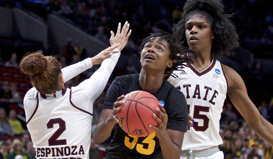 Arizona State center Charnea Johnson-Chapman, center, shoots between Mississippi State guard Andra Espinoza-Hunter, left, and center Teaira McCowan during the first half of a regional semifinal in the NCAA women's college basketball tournament Friday, March 29, 2019, in Portland, Ore. (AP Photo/Craig Mitchelldyer)