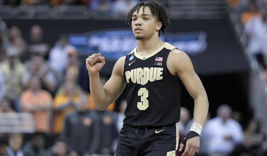 Purdue's Carsen Edwards reacts to a score during overtime of a men's NCAA Tournament college basketball South Regional semifinal game against Tennessee Thursday, March 28, 2019, in Louisville, Ky. Purdue won 99-94. (AP Photo/Timothy D. Easley)