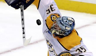 Nashville Predators goaltender Pekka Rinne blocks a shot during the first period of an NHL hockey game against the Pittsburgh Penguins in Pittsburgh, Friday, March 29, 2019. (AP Photo/Gene J. Puskar)