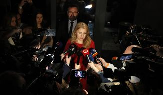 In this file picture taken on Saturday, March 16, 2019, Presidential candidate Zuzana Caputova answers questions to media as she arrives at her election headquarters to watch the results of the first round of the presidential election in Bratislava, Slovakia. Slovakia could get its first woman president as voters elect a new head of state on Saturday March 30. The leading contenders are Zuzana Caputova, an environmental activist who is in favor of gay rights and opposes a ban on abortion in this conservative Roman Catholic country, and Maros Sefcovic, an establishment figure who is the European Commission Vice-President. (AP Photo/Petr David Josek/File)