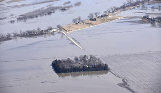 FILE - In this Monday, March 18, 2019, file photo, taken by the South Dakota Civil Air Patrol and provided by the Iowa Department of Homeland Security and Emergency Management, shows flooding along the Missouri River north of Blair, Neb. Transportation officials say it will take months to repair major roads in western Iowa damaged by spring flooding. (Iowa Homeland Security and Emergency Management via AP, File)